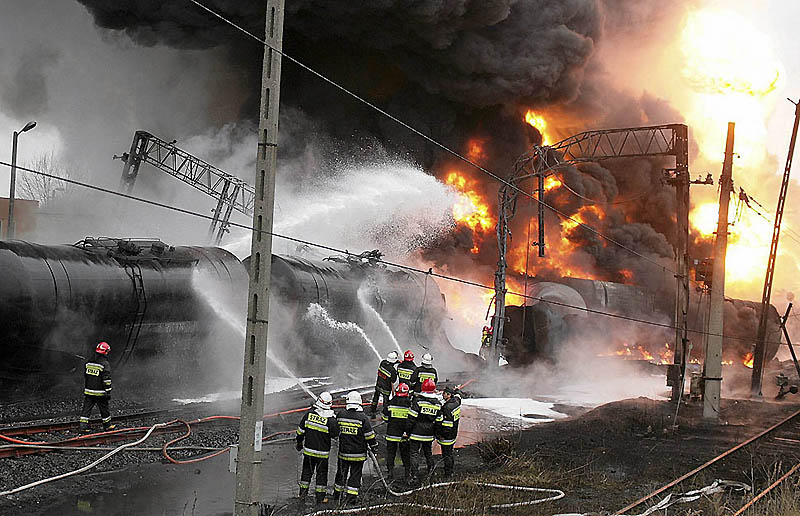 Firefighters battle a blaze caused by explosion on train cars transporting oil in Bialystok, northeastern Poland November 8, 2010.  Two oil tanker train cars blew up and more than a dozen others were set ablaze after two trains crashed into each other. One person was hurt before firefighters managed to put down the fire, local media reported. REUTERS/Agnieszka Sadowska/Agencja Gazeta (POLAND - Tags: DISASTER ENERGY) NO COMMERCIAL OR EDITORIAL SALES IN POLAND. POLAND OUT. NO COMMERCIAL OR EDITORIAL SALES IN POLAND. THIS IMAGE HAS BEEN SUPPLIED BY A THIRD PARTY. IT IS DISTRIBUTED, EXACTLY AS RECEIVED BY REUTERS, AS A SERVICE TO CLIENTS
