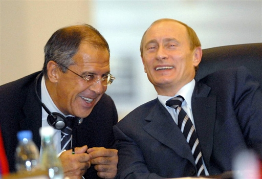 Russian President Vladimir Putin (R) shares a joke with Russia's Foreign Minister Sergei Lavrov during the Organization of the Black Sea Economic Cooperation (BSEC) summit in Istanbul, 25 June 2007. The leaders of a dozen nations in the Black Sea region, including Russia, gathered in Istanbul, 25 June 2007 under tight security to discuss ways to boost trade and economic cooperation. The summit marks the 15th anniversary of the BSEC, which promotes stability and economic ties between nations that belonged to opposite camps during the Cold War.            AFP PHOTO/ANATOLIAN NEWS AGENCY/POOL